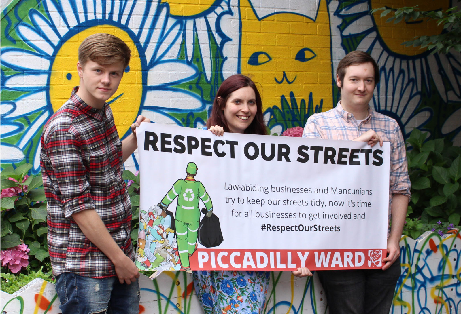 Sam, Adele and Jon-Connor holding their campaign banner